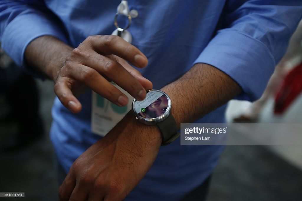 A representative gives a product demonstration of a Motorola Moto 360 watch is seen during the Google I/O Developers Conference at Moscone Center on June 25, 2014 in San Francisco, California. The seventh annual Google I/O Developers conference is expected to draw thousands through June 26.