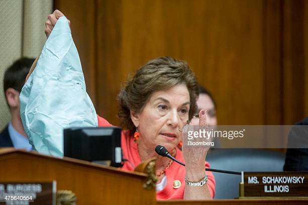Representative Jan Schakowsky a Democrat from Illinois holds up metal shards next to a faulty Takata Corp airbag during a House Energy and Commerce...