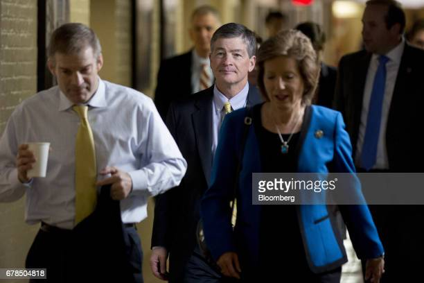 Representative Jeb Hensarling a Republican from Texas and chairman of the House Financial Services Committee center walks to a House Republican...