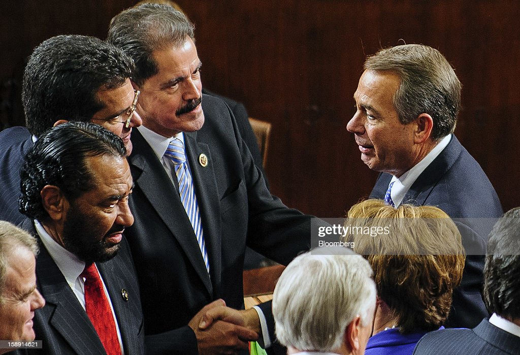 Representative <a gi-track='captionPersonalityLinkClicked' href=/galleries/search?phrase=John+Boehner&family=editorial&specificpeople=274752 ng-click='$event.stopPropagation()'>John Boehner</a>, a Republican from Ohio, right, is greeted by fellow lawmakers after being elected to a second term as Speaker of the House at the U.S. Capitol in Washington, D.C., U.S., on Thursday, Jan. 3, 2013. The 113th Congress convenes today in Washington where new members will try to meld their diverse backgrounds in a legislature containing a record seven openly gay lawmakers, an unprecedented 20 women in the Senate and the first all-female state delegation, from New Hampshire. Photographer: Pete Marovich/Bloomberg via Getty Images