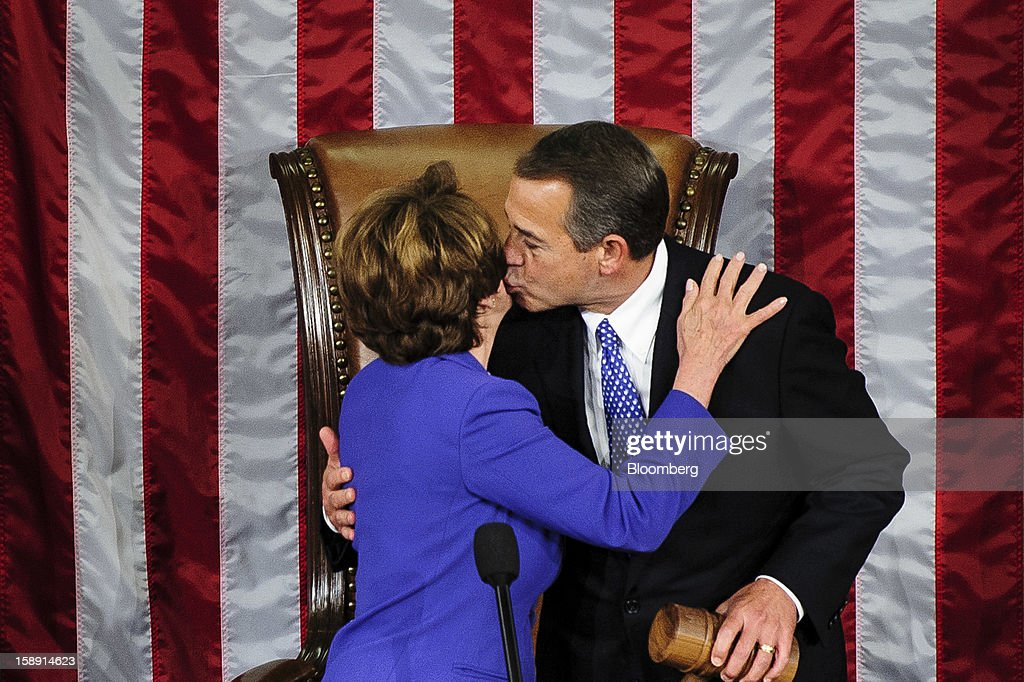 Representative <a gi-track='captionPersonalityLinkClicked' href=/galleries/search?phrase=John+Boehner&family=editorial&specificpeople=274752 ng-click='$event.stopPropagation()'>John Boehner</a>, a Republican from Ohio, right, kisses House Minority Leader <a gi-track='captionPersonalityLinkClicked' href=/galleries/search?phrase=Nancy+Pelosi&family=editorial&specificpeople=169883 ng-click='$event.stopPropagation()'>Nancy Pelosi</a>, a Democrat from California, after being elected to a second term as Speaker of the House at the U.S. Capitol in Washington, D.C., U.S., on Thursday, Jan. 3, 2013. The 113th Congress convenes today in Washington where new members will try to meld their diverse backgrounds in a legislature containing a record seven openly gay lawmakers, an unprecedented 20 women in the Senate and the first all-female state delegation, from New Hampshire. Photographer: Pete Marovich/Bloomberg via Getty Images