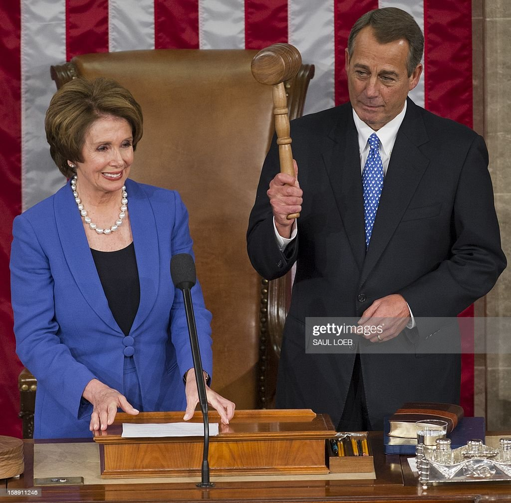 US Representative John Boehner, Republican of Ohio, holds up his gavel after being re-elected as Speaker of the House alongside US Representative Nancy Pelosi, Democrat of California and returning Minority Leader, during the opening session of the 113th US House of Representatives at the US Capitol in Washington, DC, on January 3, 2013. AFP PHOTO / Saul LOEB
