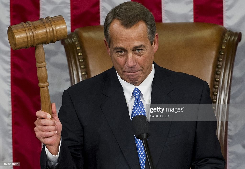 US Representative John Boehner, Republican of Ohio, holds up his gavel after being re-elected as Speaker of the House during the opening session of the 113th US House of Representatives at the US Capitol in Washington, DC, on January 3, 2013. AFP PHOTO / Saul LOEB