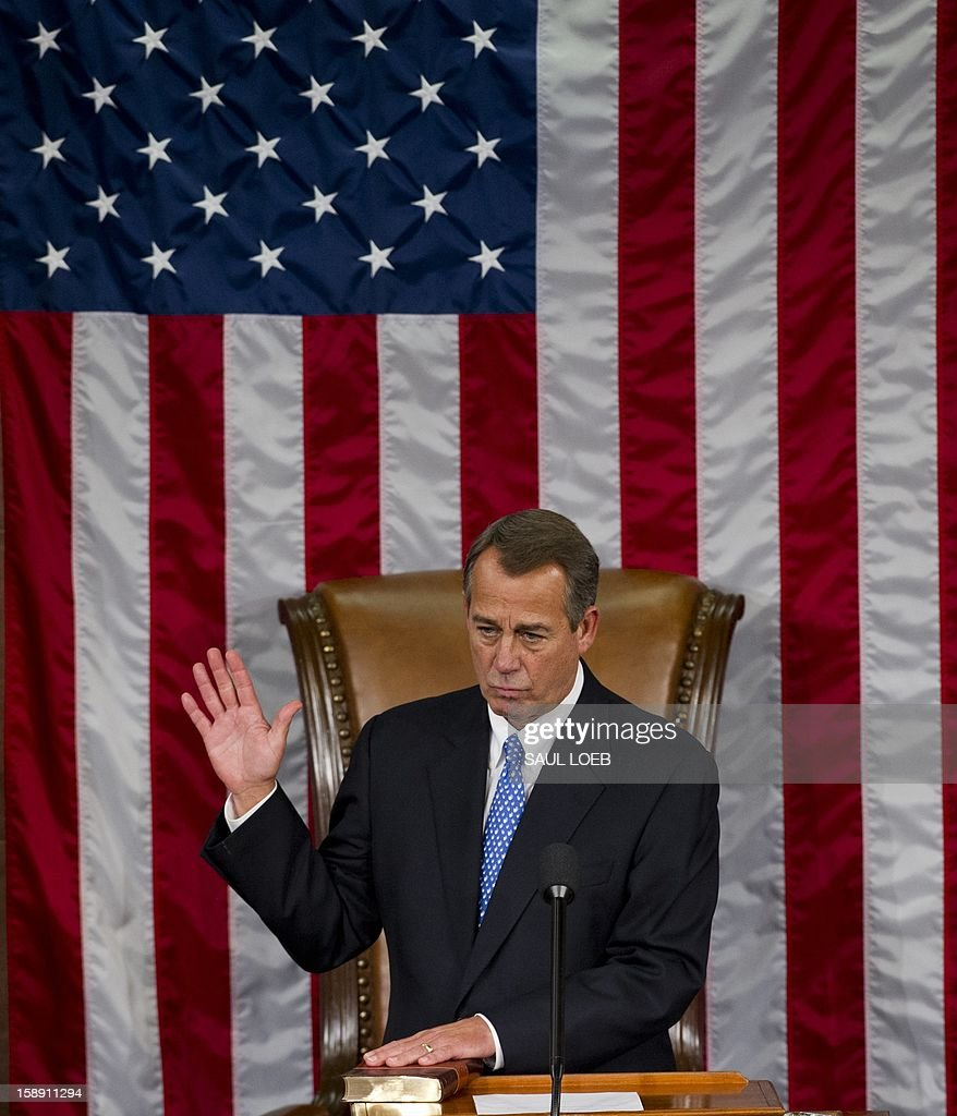 US Representative <a gi-track='captionPersonalityLinkClicked' href=/galleries/search?phrase=John+Boehner&family=editorial&specificpeople=274752 ng-click='$event.stopPropagation()'>John Boehner</a>, Republican of Ohio, takes the oath as he is sworn in after being re-elected as Speaker of the House during the opening session of the 113th US House of Representatives at the US Capitol in Washington, DC, on January 3, 2013. AFP PHOTO / Saul LOEB