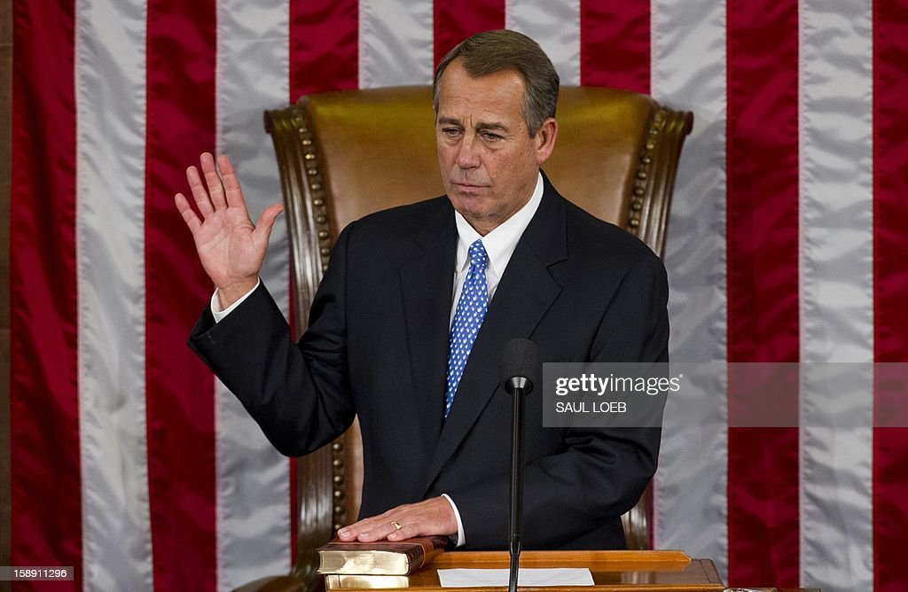 US Representative John Boehner, Republican of Ohio, takes the oath as he is sworn in after being re-elected as Speaker of the House during the opening session of the 113th US House of Representatives at the US Capitol in Washington, DC, on January 3, 2013. AFP PHOTO / Saul LOEB