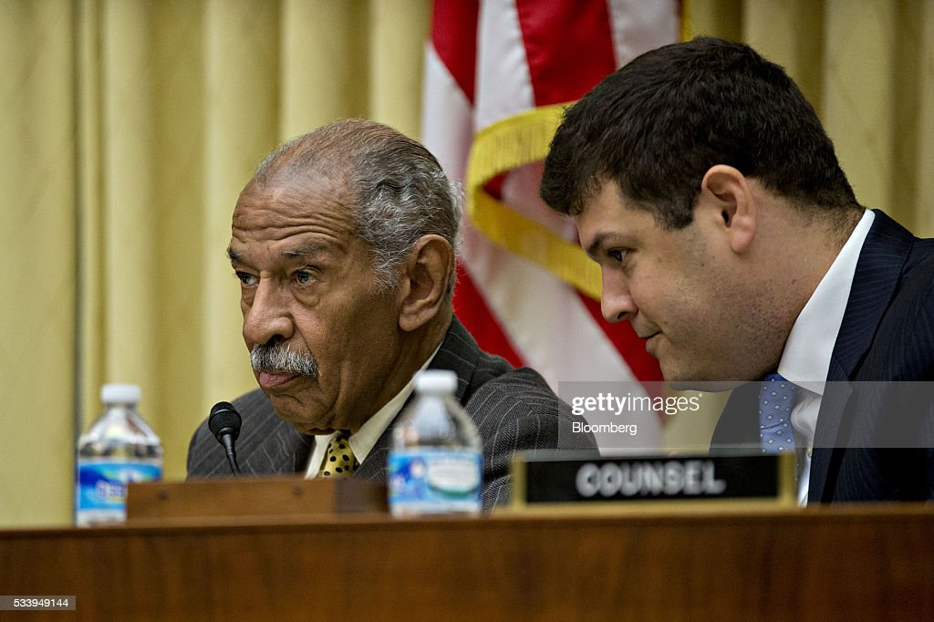 Representative <a gi-track='captionPersonalityLinkClicked' href=/galleries/search?phrase=John+Conyers&family=editorial&specificpeople=217823 ng-click='$event.stopPropagation()'>John Conyers</a>, a Democrat from Michigan and ranking member of the House Judiciary Committee, left, listens to counsel during a House Judiciary Committee hearing in Washington, D.C., U.S., on Tuesday, May 24, 2016. The hearing is part of some Republican lawmakers' push to impeach International Revenue Service (IRS) Commissioner John Koskinen for allegedly failing to cooperate with an investigation after the IRS reportedly targeted conservative groups applying for tax-exempt status