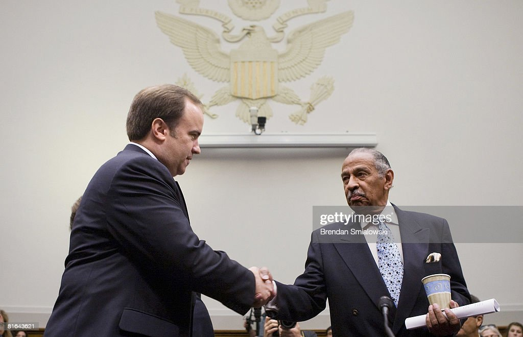 Representative John Conyers, Jr. (D-MI) (R) shakes the hand of former White House Press Secretary Scott McClellan before a hearing of the House Judiciary Committee on Capitol Hill June 20, 2008 in Washington, DC. McClellan, a former White House press secretary for U.S. President George W. Bush, appeared before the committee to testify about the leak of CIA agent Valerie Plame's identity.