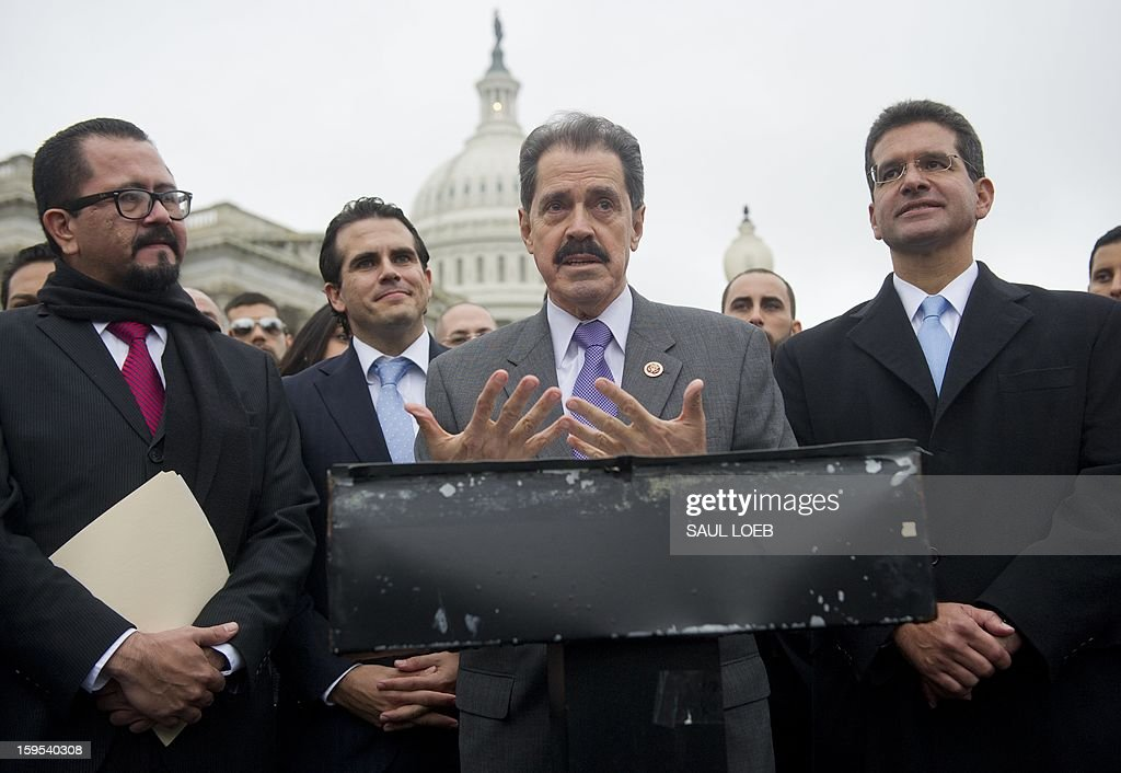 US Representative Jose Serrano (C), Democrat of New York, speaks alongside Resident Commissioner Pedro Pierluisi (R) of Puerto Rico and Puerto Rican activists, urging Congress to allow an end to the island's territorial status, during a press conference at the US Capitol in Washington, DC, on January 15, 2013. AFP PHOTO / Saul LOEB