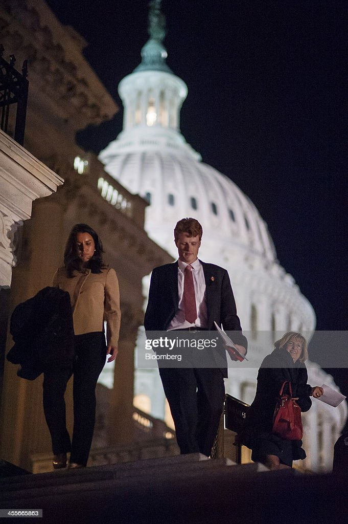 Representative Joseph 'Joe' Kennedy III, a Democrat from Massachusetts, center, leaves the U.S. Capitol following a budget deal vote in Washington, D.C., U.S., on Thursday, Dec. 12, 2013. The U.S. House passed the first bipartisan federal budget in four years, which would ease $63 billion in automatic spending cuts and avert another government shutdown. Photographer: Pete Marovich/Bloomberg via Getty Images