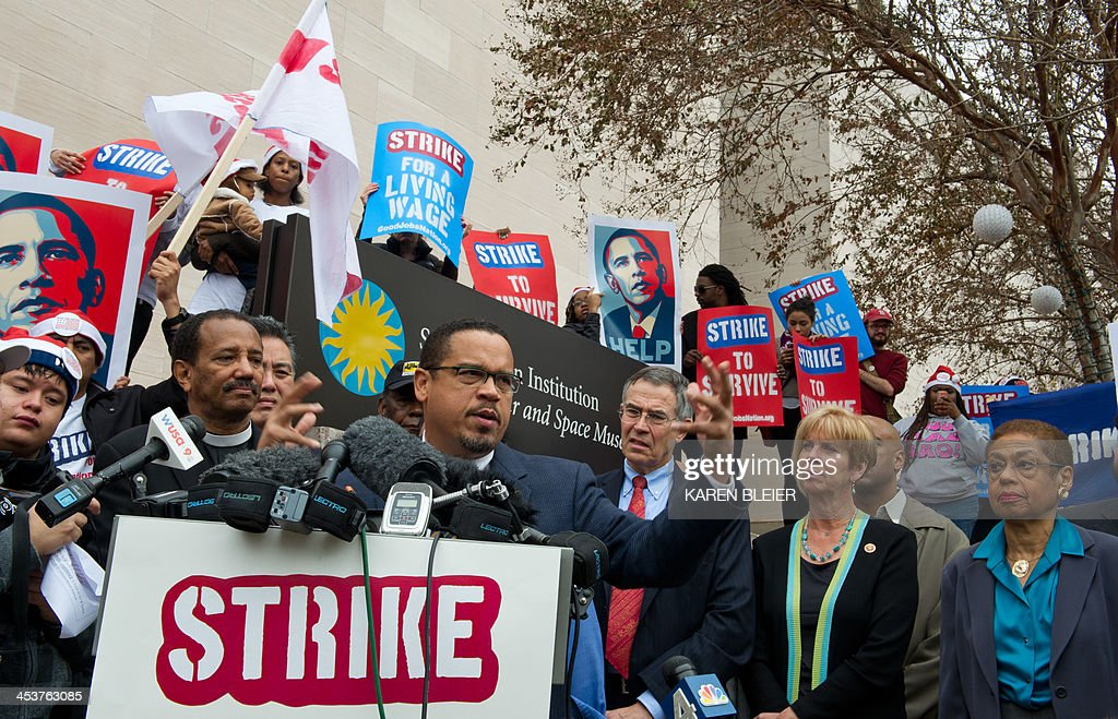 US Representative Keith Ellison(C),D-MN, speaks on behalf of demonstrators near a McDonald's restaurant outside of the Smithsonian Air and Space Museum as part of a nationwide protest of fast food workers December 5, 2013 in Washington, DC. Fast-food workers say they will sponsor one-day strikes in 100 cities on Thursday and protest activities in 100 additional cities to demand McDonalds, Burger King, Taco Bell, Wendy's and other fast-food restaraunts to pay a 15USD-an-hour wage. AFP PHOTO / Karen BLEIER