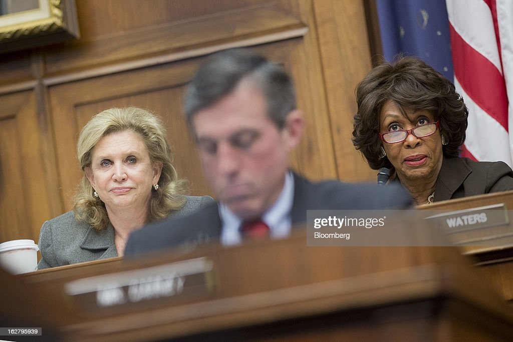 Representative <a gi-track='captionPersonalityLinkClicked' href=/galleries/search?phrase=Maxine+Waters&family=editorial&specificpeople=220525 ng-click='$event.stopPropagation()'>Maxine Waters</a>, a Democrat from California, right, makes an opening statement during a House Financial Services Committee hearing with Representative Carolyn Maloney, a Democrat from New York, left, and Ben S. Bernanke, chairman of the U.S. Federal Reserve, not pictured, in Washington, D.C., U.S., on Wednesday, Feb. 27, 2013. Bernanke signaled the Fed is prepared to keep buying bonds at its present pace as he dismissed concerns record easing risks sparking inflation or fueling asset price bubbles. Photographer: Andrew Harrer/Bloomberg via Getty Images