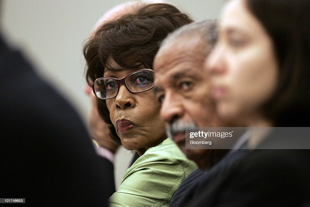 Representative <a gi-track='captionPersonalityLinkClicked' href=/galleries/search?phrase=Maxine+Waters&family=editorial&specificpeople=220525 ng-click='$event.stopPropagation()'>Maxine Waters</a> of California, left, and Representative <a gi-track='captionPersonalityLinkClicked' href=/galleries/search?phrase=John+Conyers&family=editorial&specificpeople=217823 ng-click='$event.stopPropagation()'>John Conyers</a> of Michigan, both Democrats, listen to testimony during a a hearing of the House Judiciary Committee on the proposed Comcast-NBC merger in Los Angeles, California, U.S., on Monday, June 7, 2010. Comcast Corp. will add at least three cable networks with minority ownership to its channel lineup after taking over General Electric Co.'s NBC Universal unit, the companies said. Photographer: Jonathan Alcorn/Bloomberg via Getty Images