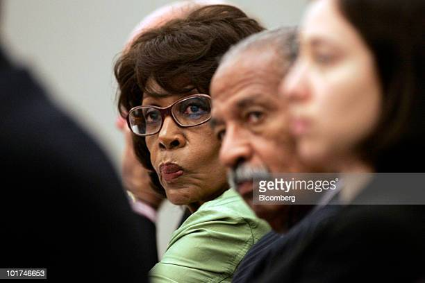 Representative Maxine Waters of California left and Representative John Conyers of Michigan both Democrats listen to testimony during a a hearing of...