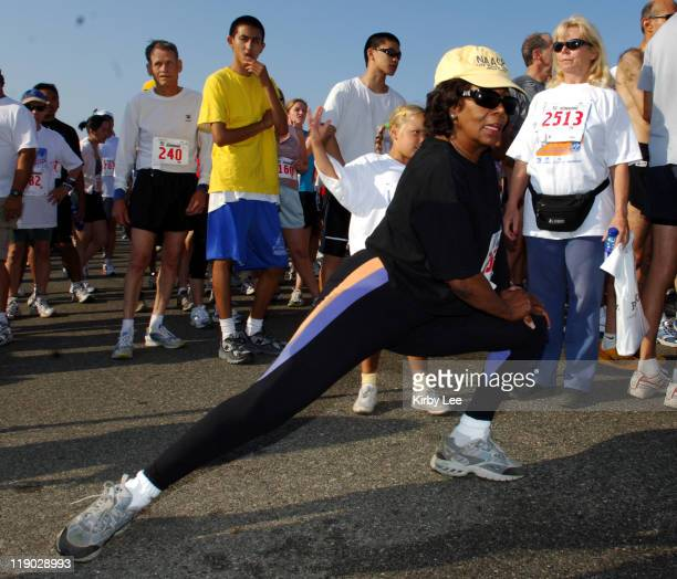 US Representative Maxine Waters of the 35th Congressional District stretches before the start of the 13th annual Keep LA Running 5 and 10K at...