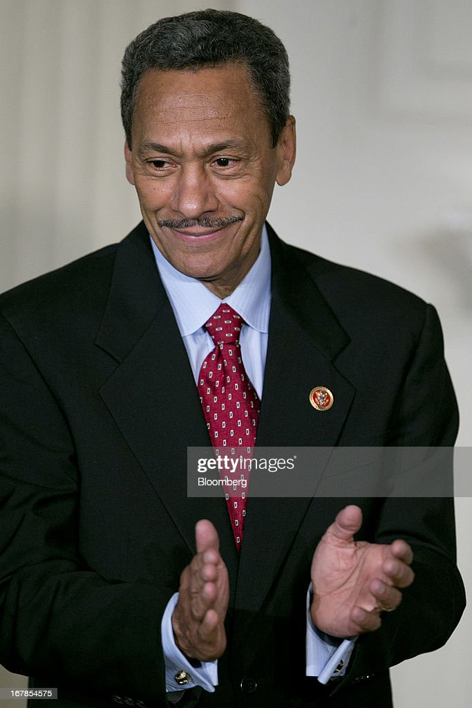Representative Mel Watt, a Democrat from North Carolina and U.S. President Barack Obama's nominee as director of the Federal Housing Finance Agency (FHFA), claps as Obama, not pictured, makes the announcement in the State Dining Room of the White House in Washington, D.C., U.S. on Wednesday, May 1, 2013. Obama nominated Watt to be director of the Federal Housing Finance Agency after months of political pressure from consumer advocates to find a new overseer for Fannie Mae and Freddie Mac. Photographer: Andrew Harrer/Bloomberg via Getty Images