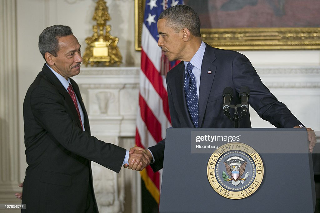 Representative Mel Watt, a Democrat from North Carolina and U.S. President <a gi-track='captionPersonalityLinkClicked' href=/galleries/search?phrase=Barack+Obama&family=editorial&specificpeople=203260 ng-click='$event.stopPropagation()'>Barack Obama</a>'s nominee as director of the Federal Housing Finance Agency (FHFA), left, shakes hands with Obama during the announcement in the State Dining Room of the White House in Washington, D.C., U.S. on Wednesday, May 1, 2013. Obama nominated Watt to be director of the Federal Housing Finance Agency after months of political pressure from consumer advocates to find a new overseer for Fannie Mae and Freddie Mac. Photographer: Andrew Harrer/Bloomberg via Getty Images