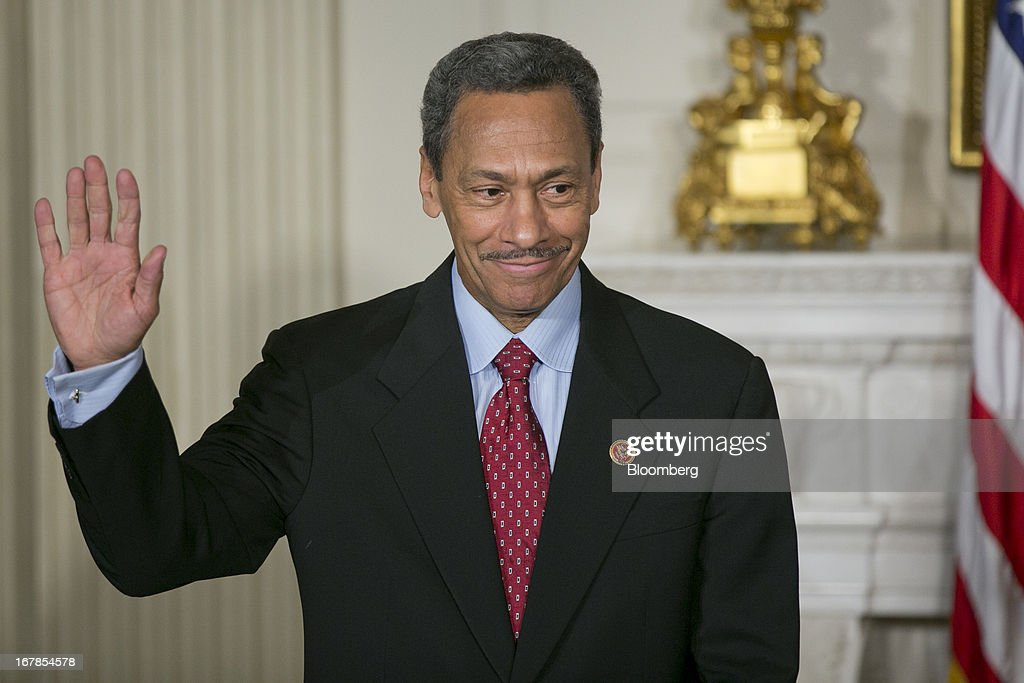 Representative Mel Watt, A Democrat from North Carolina and U.S. President Barack Obama's nominee as director of the Federal Housing Finance Agency (FHFA), gestures as Obama, not pictured, makes the announcement in the State Dining Room of the White House in Washington, D.C., U.S. on Wednesday, May 1, 2013. Obama nominated Watt to be director of the Federal Housing Finance Agency after months of political pressure from consumer advocates to find a new overseer for Fannie Mae and Freddie Mac. Photographer: Andrew Harrer/Bloomberg via Getty Images