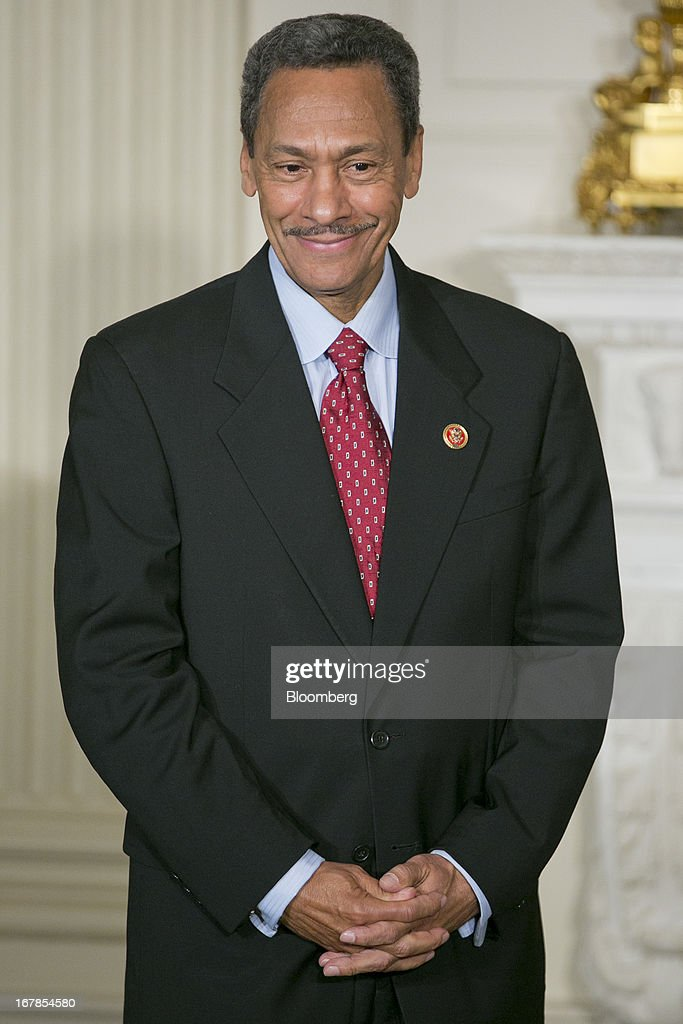 Representative Mel Watt, A Democrat from North Carolina and U.S. President Barack Obama's nominee as director of the Federal Housing Finance Agency (FHFA), smiles as Obama, not pictured, makes the announcement in the State Dining Room of the White House in Washington, D.C., U.S. on Wednesday, May 1, 2013. President Barack Obama nominated Representative Mel Watt to be director of the Federal Housing Finance Agency after months of political pressure from consumer advocates to find a new overseer for Fannie Mae and Freddie Mac. Photographer: Andrew Harrer/Bloomberg via Getty Images