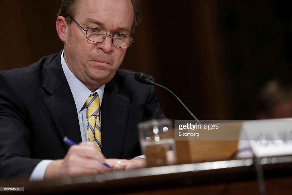 Representative Mick Mulvaney, a Republican from South Carolina and Office of Management and Budget director nominee for U.S. President Donald Trump, makes notes during a Senate Governmental Affairs Committee confirmation hearing in Washington, D.C., U.S., on Tuesday, Jan. 24, 2017. Mulvaney said Tuesday the nearly $20 trillion national debt needs to be 'addressed sooner rather than later' and that he would push Trump to break his campaign promises and cut Social Security and Medicare. Photographer: Aaron P. Bernstein/Bloomberg via Getty Images