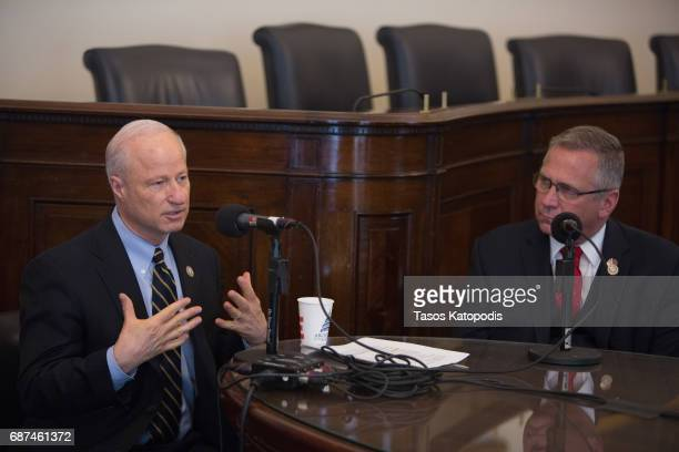 Representative Mike Coffman and Congressman Tim Walz at SiriusXM's Congressional Veterans Forum at the Cannon House Office Building on May 23 2017 in...