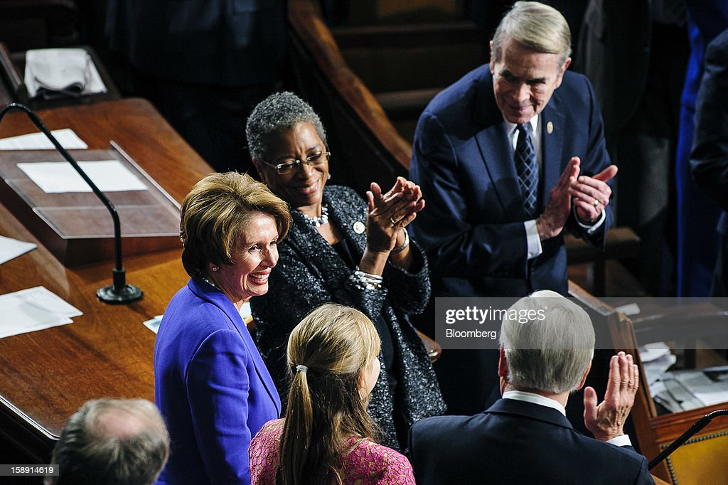 Representative <a gi-track='captionPersonalityLinkClicked' href=/galleries/search?phrase=Nancy+Pelosi&family=editorial&specificpeople=169883 ng-click='$event.stopPropagation()'>Nancy Pelosi</a>, a Democrat from California, left, receives applause after being re-elected as House Minority Leader at the U.S. Capitol in Washington, D.C., U.S., on Thursday, Jan. 3, 2013. The 113th Congress convenes today in Washington where new members will try to meld their diverse backgrounds in a legislature containing a record seven openly gay lawmakers, an unprecedented 20 women in the Senate and the first all-female state delegation, from New Hampshire. Photographer: Pete Marovich/Bloomberg via Getty Images