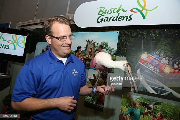 A representative of Busch Gardens holds a bird at The 10th Annual New York Times Travel Show Ribbon Cutting And Preview at Javits Center on January...