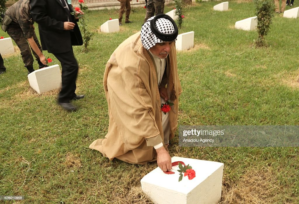 Representative of El-Lami tribe, Ali El-Lami leaves red cloves at the Ottoman Turkish Martyrs cemetery during the ceremony held for 100th anniversary of the Kut al-Amara victory against the British, in Kut, Iraq on April 29, 2016.