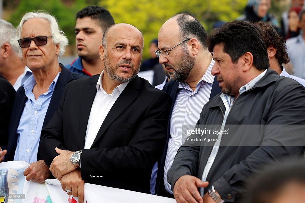 Representative of Hamas in Lebanon Ali Baraka (L) and Ahmed Abdul Hadi (2nd L) attend a protest after the UNRWA decision to reduce the health, finance and education services, in front of the United Nations Relief and Works Agency for Palestine Refugees in the Near East (UNRWA) office in Beirut, Lebanon on May 6, 2016.