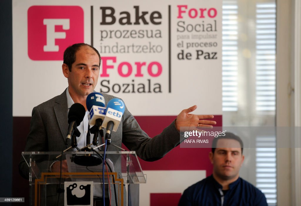 Representative of Lokarri Paul Rios (L) and representative of Bake Bidea Peio Dufau (R) take part during a press conference in San Sebastian on December 23, 2013 organised by Basque nationalist associations Bake Bidea and Lokarri to announce the creation of a civil commission to 'boost the peace process', amid persistent rumors of an upcoming deposition of weapons by the separatist group ETA. 'The commission will be responsible for managing a series of recommendations such as disarmament (...) the dismantling of ETA's military structures, rehabilitation of prisoners (...) with the institutions, political parties and actors involved in the peace process ', stated the two associations. AFP PHOTO / RAFA RIVAS