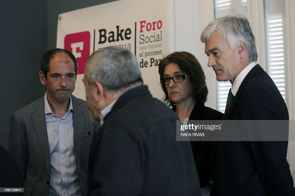 Representative of Lokarri Paul Rios (L), listens to Fernando Armendariz (2nd L) beside Maite Perez (3rd L) and Nazario Oleaga (R) during a press conference in San Sebastian on December 23, 2013 organised by Basque nationalist associations Bake Bidea and Lokarri to announce the creation of a civil commission to 'boost the peace process', amid persistent rumors of an upcoming deposition of weapons by the separatist group ETA. 'The commission will be responsible for managing a series of recommendations such as disarmament (...) the dismantling of ETA's military structures, rehabilitation of prisoners (...) with the institutions, political parties and actors involved in the peace process ', stated the two associations. AFP PHOTO / RAFA RIVAS