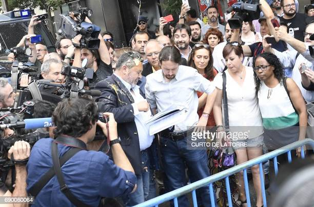 A representative of taxi drivers is hit by an egg that splashes leader of lieft wing party Podemos leader Pablo Iglesias during a strike action held...