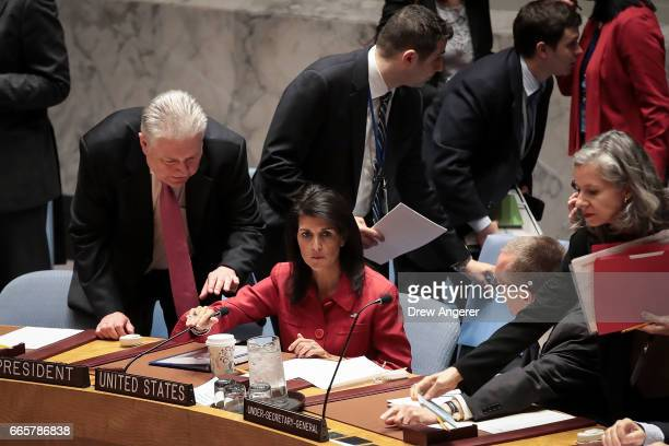 Representative of Ukraine to the United Nations Volodymyr Yelchenko speaks to US Ambassador to the United Nations Nikki Haley during a meeting of the...