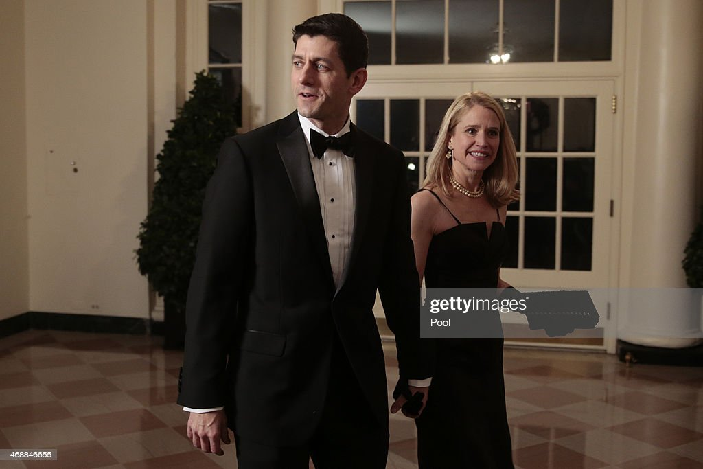 Representative Paul Ryan, a Republican from Wisconsin, left, and <a gi-track='captionPersonalityLinkClicked' href=/galleries/search?phrase=Janna+Ryan&family=editorial&specificpeople=9632767 ng-click='$event.stopPropagation()'>Janna Ryan</a> arrive to a state dinner hosted by U.S. President Barack Obama and U.S. first lady Michelle Obama in honor of French President Francois Hollande at the White House on February 11, 2014 in Washington, DC. Obama and Hollande said the U.S. and France are embarking on a new, elevated level of cooperation as they confront global security threats in Syria and Iran, deal with climate change and expand economic cooperation.