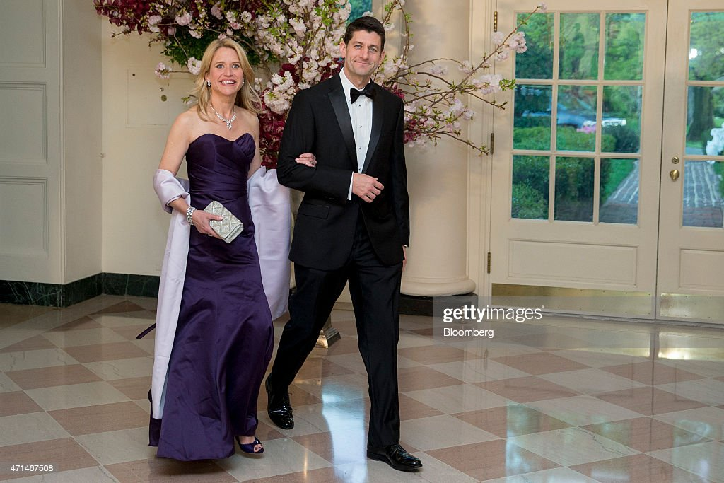 Representative Paul Ryan, a Republican from Wisconsin, right, and Janna Ryan arrive at a state dinner hosted by U.S. President Barack Obama and U.S. First Lady Michelle Obama in honor of Japan's Prime Minister Shinzo Abe at the White House in Washington, D.C., U.S., on Tuesday, April 28, 2015. Prime Minister Shinzo Abe goes before the U.S. Congress on Wednesday to present Japan as a stalwart ally that's willing to play a bigger military role in Asia, a message likely to be embraced in Washington and greeted with suspicion in Seoul and Beijing. Photographer: Andrew Harrer/Bloomberg via Getty Images