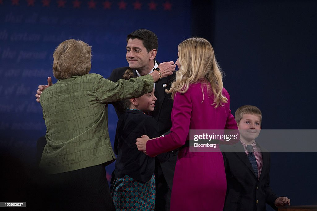 "Representative Paul Ryan, Republican vice presidential candidate, hugs family members after a debate in Danville, Kentucky, U.S., on Thursday, Oct. 11, 2012. Paul Ryan said President Barack Obama is presiding over a ""chaotic"" foreign policy that is 'unraveling'' and making the US. ""less safe,"" as he began his debate tonight with Joe Biden. Photographer: Scott Eells/Bloomberg via Getty Images"