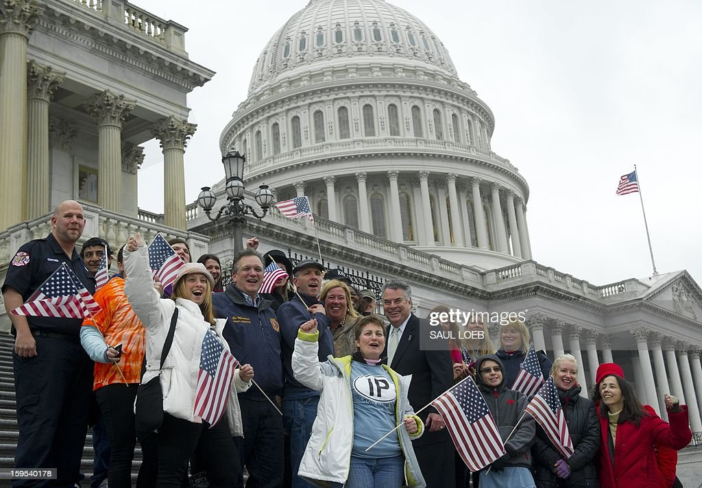 US Representative Peter King (C), Republican of New York, stands with New York area first responders and victims of Superstorm Sandy on the steps of the US Capitol in Washington, DC, on January 15, 2013, prior to a vote by the US House of Representatives on a $50.7 billion aid package for victims of the storm. AFP PHOTO / Saul LOEB