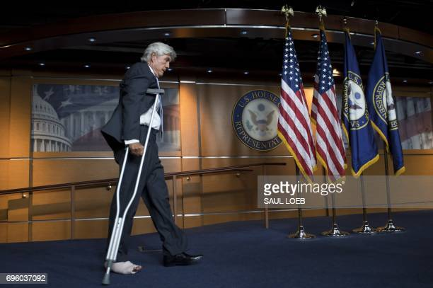 Representative Roger Williams Republican of Texas and a coach of the US House Republican baseball team arrives on crutches after being injured by...
