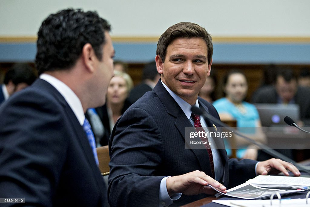 Representative Ron DeSantis, a Republican from Florida, right, talks to Representative <a gi-track='captionPersonalityLinkClicked' href=/galleries/search?phrase=Jason+Chaffetz&family=editorial&specificpeople=5610304 ng-click='$event.stopPropagation()'>Jason Chaffetz</a>, a Republican from Utah and chairman of the House Oversight and Government Reform Committee, before a House Judiciary Committee hearing in Washington, D.C., U.S., on Tuesday, May 24, 2016. The hearing is part of some Republican lawmakers' push to impeach International Revenue Service (IRS) Commissioner John Koskinen for allegedly failing to cooperate with an investigation after the IRS reportedly targeted conservative groups applying for tax-exempt status
