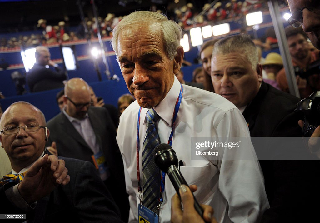 Representative <a gi-track='captionPersonalityLinkClicked' href=/galleries/search?phrase=Ron+Paul&family=editorial&specificpeople=2300665 ng-click='$event.stopPropagation()'>Ron Paul</a>, a Republican from Texas, speaks to the media at the Republican National Convention (RNC) in Tampa, Florida, U.S., on Tuesday, Aug. 28, 2012. Delegates are gathered in Tampa at the 40th Republican National Convention to select former Massachusetts governor Mitt Romney as their nominee for the next president of the United States. Photographer: Daniel Acker/Bloomberg via Getty Images
