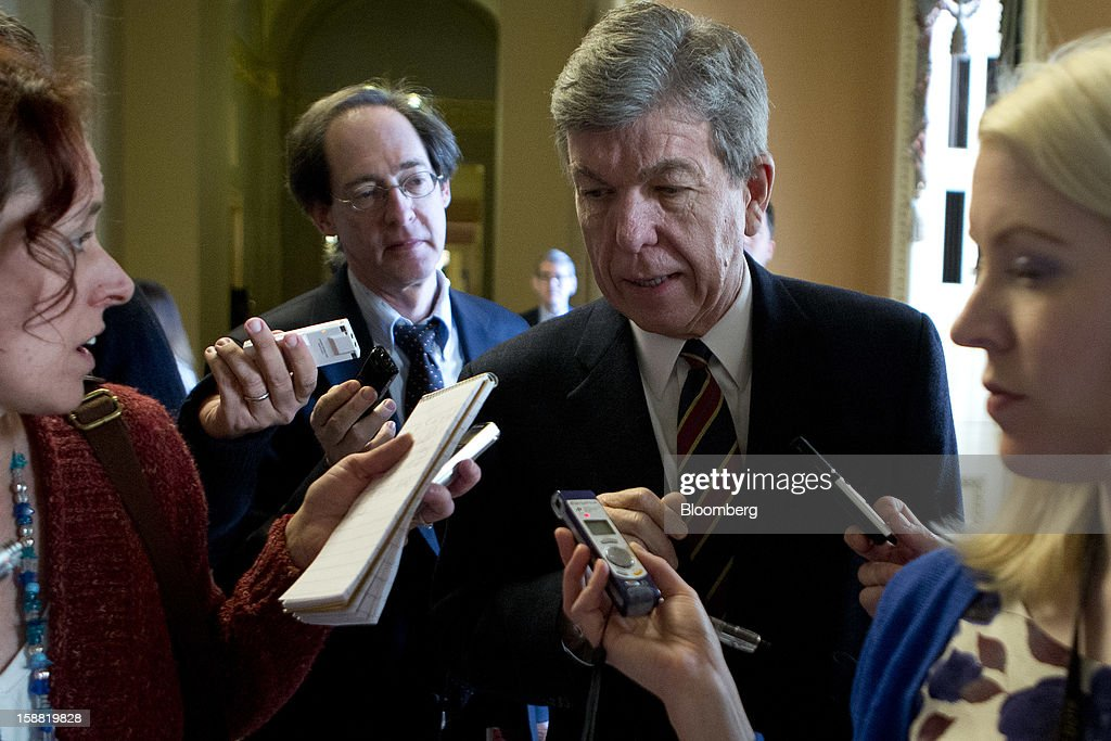 Representative Roy Blunt, a Republican from Missouri, second right, speaks to members of the media about fiscal negotiations at the U.S. Capitol in Washington, D.C., U.S., on Sunday, Dec. 30, 2012. Senate Majority Leader Harry Reid rejected the latest Republican offer to resolve the U.S. fiscal crisis as Minority Leader Mitch McConnell reached out to Vice President Joe Biden in an effort to break the impasse. Photographer: Andrew Harrer/Bloomberg via Getty Images