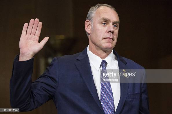 Representative Ryan Zinke US secretary of interior nominee for presidentelect Donald Trump is sworn in to a Senate Energy and Natural Resources...