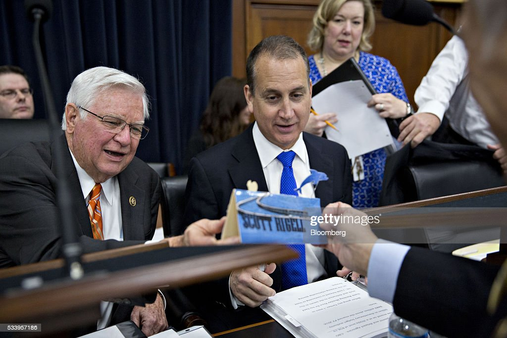 Representative Scott Rigell, a Republican from Virginia, right, shows Representative Harold 'Hal' Rogers, a Republican from Kentucky and chairman of the House Appropriations Committee, left, and Representative Mario Diaz-Balart, a Republican from Florida, a handmade name placard before the start of a House Appropriations Committee markup in Washington, D.C., U.S., on Tuesday, May 24, 2016. The committee was meeting on the markup of the FY2017 Commerce, Justice and Science bill and the FY 2017 Transportation, Housing and Urban Development Appropriations bill. Photographer: Andrew Harrer/Bloomberg via Getty Images