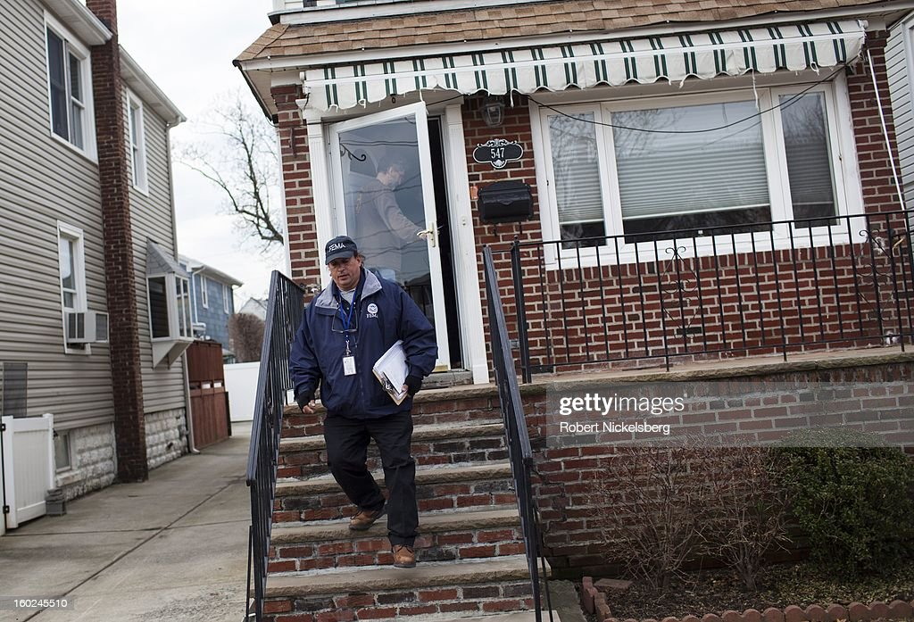 A FEMA representative surveys a resident about heat and power availability January 17, 2013 in a neighborhood damaged during Hurricane Sandy in the Rockaways January 17, 2013 in the Queens borough of New York. A $50.7 billion Superstorm Sandy aid package was voted through the House of Representatives recently. The funding would be spent on New York and New Jersey transit systems and for the Federal Emergency Management Agency's disaster relief fund.