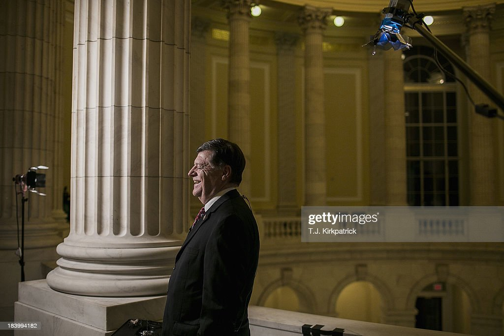 Representative Tom Cole (R-OK) waits to appear in a live CNN interview as congressional staff continue negotiations in to the night at the U.S. Capitol on October 10, 2013 in Washington, DC. House Speaker John Boehner suggested earlier today that Republicans may be willing to offer a short-term debt limit increase to allow for time to negotiate on reopening the government.