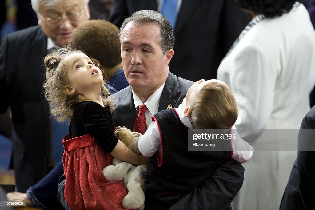 Representative <a gi-track='captionPersonalityLinkClicked' href=/galleries/search?phrase=Trent+Franks&family=editorial&specificpeople=703239 ng-click='$event.stopPropagation()'>Trent Franks</a>, a Republican from Arizona, center, holds his children, Emily and Joshua, as the 112th Congress convenes in Washington, D.C., U.S., on Wednesday, Jan. 5, 2010. House Speaker John Boehner is promising to 'give government back to the people' and make 'tough decisions' to cut spending as he becomes the U.S. House of Representatives' 53rd speaker today. Photographer: Joshua Roberts/Bloomberg via Getty Images