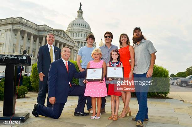Representative Trent Franks with Mia Robertson Cole Robertson Missy Robertson Reed Robertson and Jase Robertson of the television show 'Duck Dynasty'...