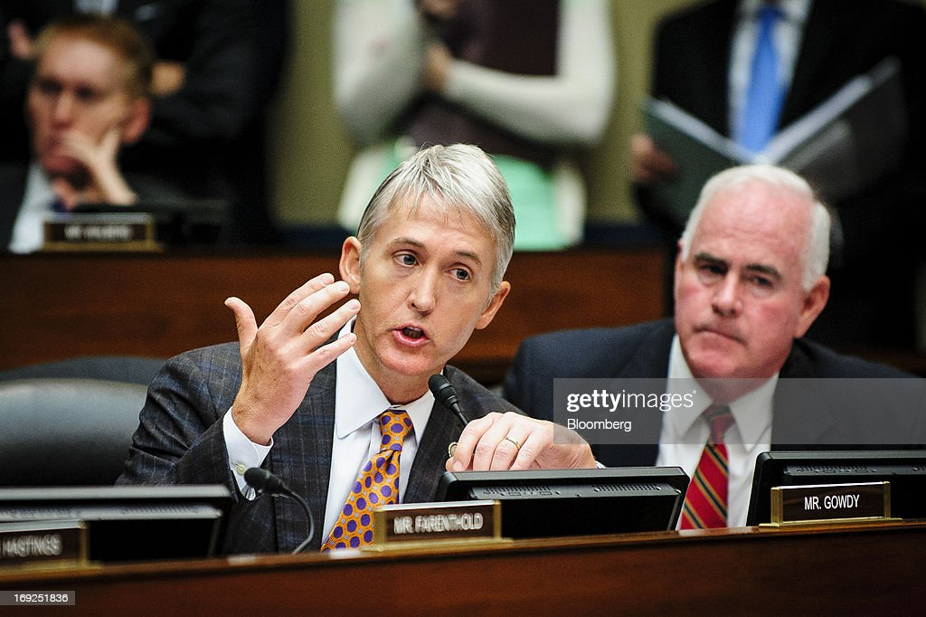 Representative Trey Gowdy, a Republican from South Carolina, left, objects to Lois Lerner's, the director of the Internal Revenue Service's (IRS) exempt organizations office, unseen, refusal to answer questions, during a House Oversight and Government Reform Committee hearing in Washington, D.C., U.S., on Wednesday, May 22, 2013. Lerner, the mid-level IRS official at the center of a controversy over treatment of small-government groups, invoked her right not to testify after reading a statement denying that she had committed any crimes. Photographer: Pete Marovich/Bloomberg via Getty Images