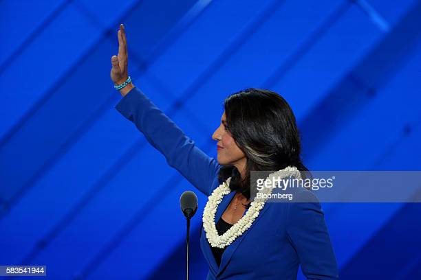 Representative Tulsi Gabbard a Democrat from Hawaii waves while speaking during the Democratic National Convention in Philadelphia Pennsylvania US on...