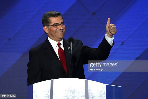 S Representative Xavier Becerra gestures to the crowd as he delivers remarks on the fourth day of the Democratic National Convention at the Wells...