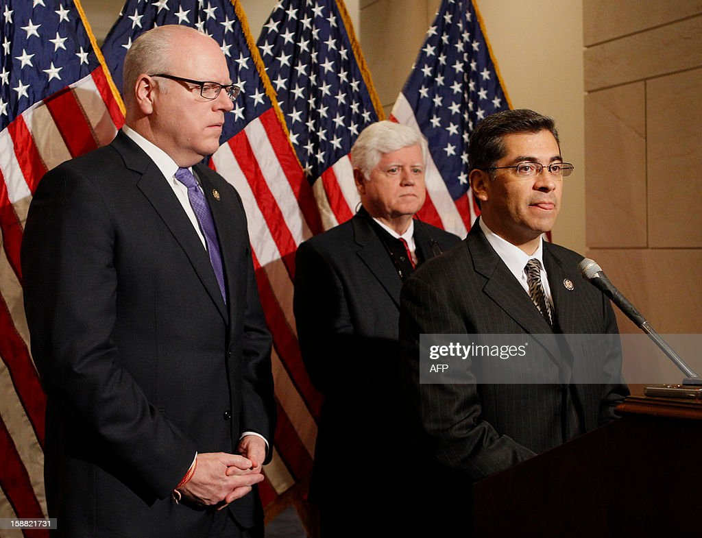 Representative Xavier Becerra (D-CA) speaks during a press conference with House Democratic Caucus Chairman Rep. John Larson (D-CT) (C) and Rep. Joe Crowley (D-NY) after their caucus meeting in the US Capitol on December 30, 2012 in Washington, DC. Last minute talks stalled Sunday between top US political leaders aimed at averting a fiscal calamity due to hit within hours, as Democrats and Republicans blamed each other for a lack of progress. Top Democrats and Republicans groped for a compromise before a punishing package of government spending cuts and tax hikes come into force on January 1 which could roil global markets and send the US economy back into recession. AFP PHOTO/Molly RILEY